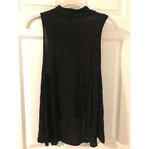 Black sleeveless turtleneck flowy crop